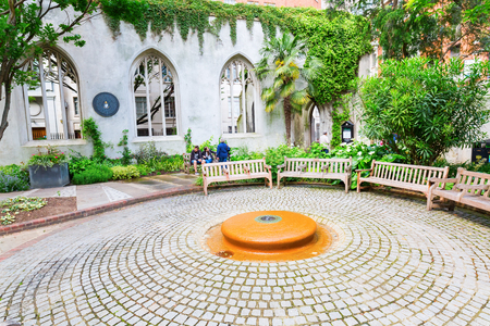 largely: London, UK - June 17, 2016: ruin of the church St Dunstan-in-the-East in the City of London with unidentified people. The church was largely destroyed in the 2nd WW, the ruins are now public garden. Editorial