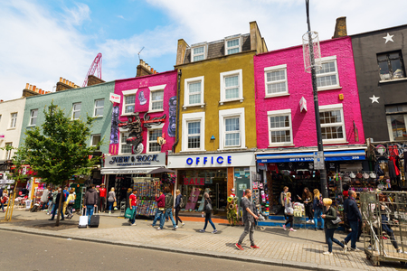 London, UK - June 17, 2016: unique shopping street in Camden with unidentified people. The area hosts street markets and music venues which are strongly associated with alternative culture