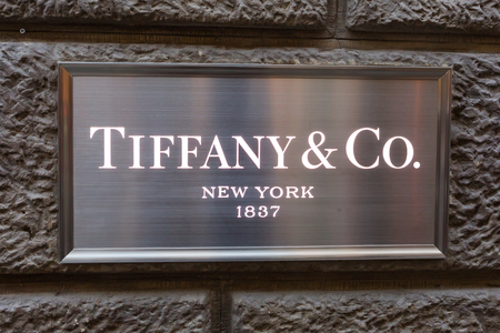 co: Florence, Italy - July 05, 2016: emblem with the logo of Tiffany and Co. Tiffany and Company is an American luxury jewelry and specialty retailer, headquartered in New York City Editorial