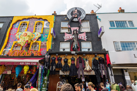 venues: London, UK - June 17, 2016: unique shopping street in Camden with unidentified people. The area hosts street markets and music venues which are strongly associated with alternative culture