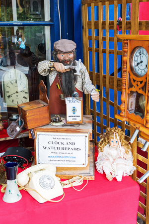 portobello: London, UK - June 19, 2016: antique shop at Portobello Road. The road is well known for its Portobello Road Market, one of Londons notable street markets with second-hand clothes and antiques Editorial