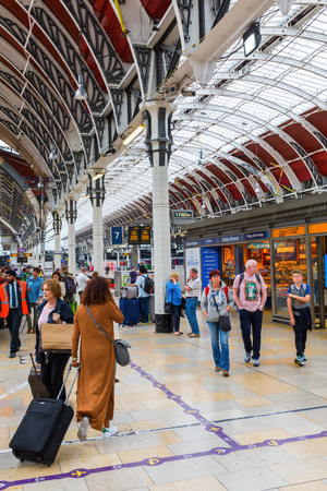 London, UK - June 19, 2016: London Paddington station with unidentified people. Much of the main-line station dates from 1854 and was designed by Isambard Kingdom Brunel Editorial