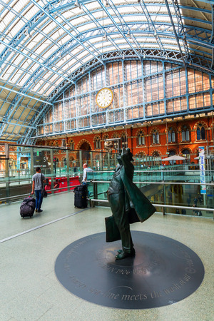 sir: London, UK - June 16, 2016: Sir Betjeman Statue at St. Pancras Station with unidentified people. Sir John Betjeman was responsible for saving the Station and the Chambers from demolition in the 1960s