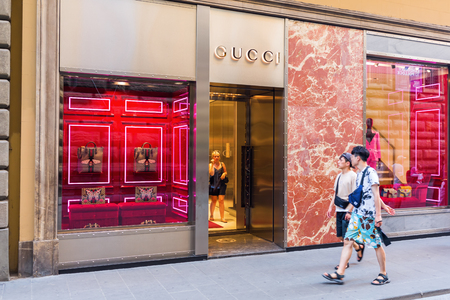 gucci store: Florence, Italy - July 05, 2016: Gucci shop in the city center of Florence. Florence is a well known shopping location with a high concentration of boutiques from fashion icons