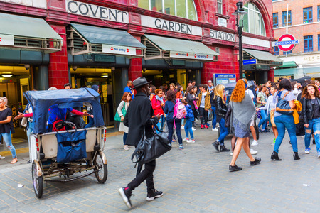 tourist site: London, UK - June 16, 2016: street scene with unidentified people at Covent Garden. It is a district in London, a former market square, now a popular shopping and tourist site