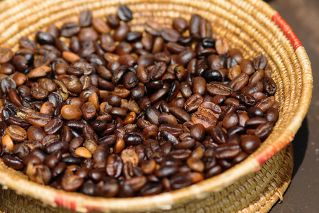 wattled: coffee beans in a wattled bowl Stock Photo