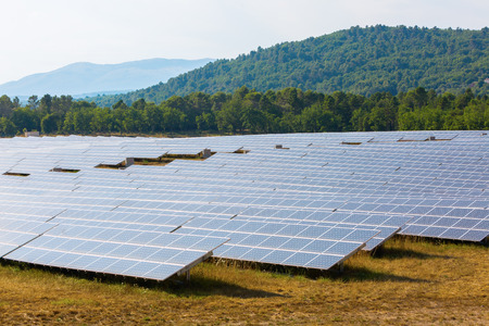 field with solar collectors in a landscape