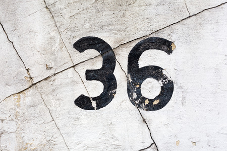 number 36: number 36 painted on a cracked house wall