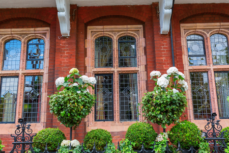 beautiful decorated fence in front of a lordly historical building in Kensington, London Stock Photo
