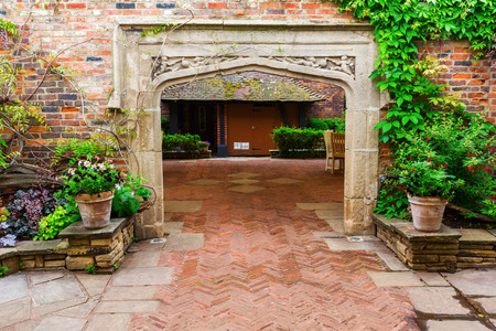 kensington: London, UK - June 21, 2016: Kensington Roof Gardens in London. Its a stunning 1.5 acres rooftop garden, divided in traditional English, formal Spanish and Tudor areas, free accessibility by day