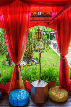 London, UK - June 21, 2016: Kensington Roof Gardens in London. Its a stunning 1.5 acres rooftop garden, divided in traditional English, formal Spanish and Tudor areas, free accessibility by day