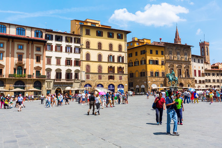 signoria square: Florence, Italy - July 04, 2016: Piazza della Signoria with unidentified people. The famous square is a tourism magnet, it is the heart of Florentine history in front of the Palazzo Vecchio.