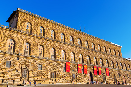 Florence, Italy - July 03, 2016: Palazzo Pitti with unidentified people. The palazzo is today the largest museum complex in Florence.