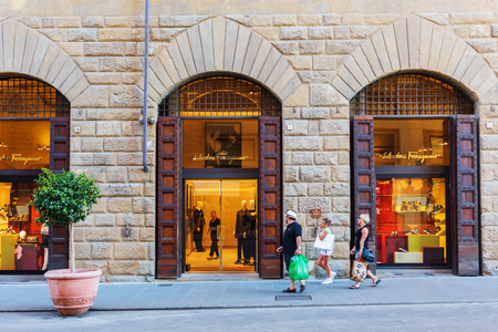 Florence, Italy - July 03, 2016: Salvatore Ferragamo shop in Florence with unidentified people. Florence is a well known shopping location with a high concentration of boutiques from fashion icons