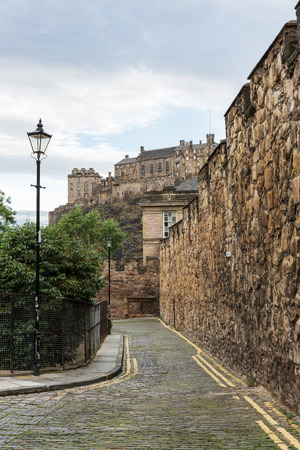 cobblestone road: cobblestone road in Edinburgh, Scotland, with view to Edinburgh Castle Editorial