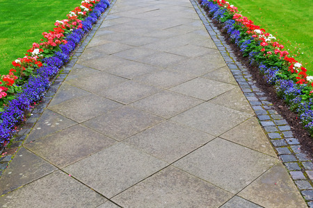 zoned: footpath from conrete paver zoned by a flower border