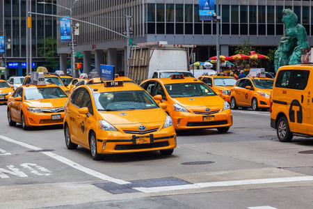 recognized: New York City, USA - October 07, 2015: yellow cabs in Manhattan, NYC. The taxicabs of New York City are Widely Recognized icons of the city Editorial