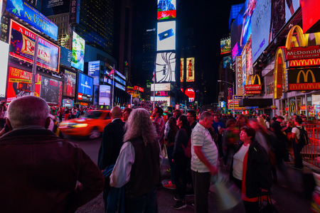 broadway tower: New York City, USA - October 08, 2015: Times Square at night with unidentified people. It is one of the worlds busiest pedestrian intersections and a major center of worlds entertainment industry