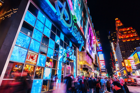 New York City, USA - October 08, 2015: Times Square at night with unidentified people. It is one of the worlds busiest pedestrian intersections and a major center of worlds entertainment industry
