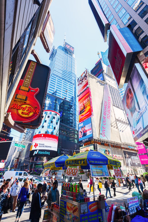 hard times: New York City, USA - October 06, 2015: Times Square in midtown Manhattan. It is one of the worlds busiest pedestrian intersections and a major center of worlds entertainment industry