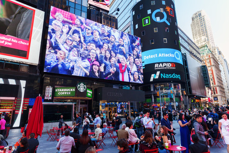broadway tower: New York City, USA - October 06, 2015: big screen at Times Square with unidentified people. It is one of the worlds busiest pedestrian intersections and a major center of worlds entertainment industry