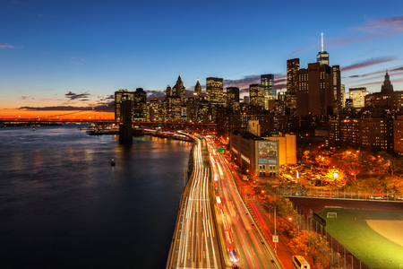 New York City, USA - October 15, 2015: view of Lower Manhattan with the East River at night. The metropolitan area NYC is one of the most important economy areas and commercial center of the world