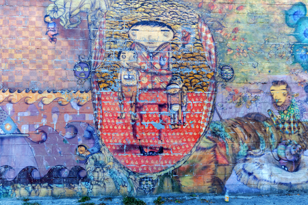 os: New York City, USA - October 11, 2015: mural of Os Gemeos in Coney Iceland. Os Gemeos are Brasilian twins, who are Regarded as the most prominent Representatives of the Brazilian street art