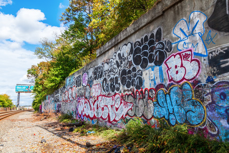 New York City, USA - October 14, 2015: graffiti at at railroad tunnel in Manhattan. NYC is known for its excessive graffiti art.