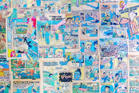 New York City, USA - October 10, 2015: antique comics used as wallpaper in a restaurant. Comics had a lowbrow reputation for much of history, at end of the 20th century began They find greater acceptance Publikacyjne