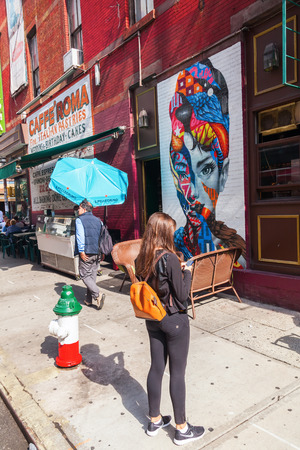 New York City, USA - October 09, 2015: Audrey Hepburn mural with unidentified people. Its part of the LISA Project did brings artists together in Little Italy in Manhattan creating only mural arts district