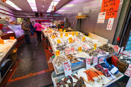 New York City, USA - October 08, 2015: fishshop in Chinatown, Manhattan, with unidentified people. Chinatown, Manhattan, is home to the large largest enclave of Chinese people in the Western Hemisphere
