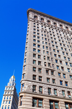 New York City, USA - October 10, 2015: Flatiron Building in Manhattan. Its a steel framed skyscraper historical, designated as NYC landmark and a National Historic Landmark and registered in Historic Places