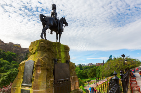 princes street: Edinburgh, Scotland - September 11, 2016: Royal Scots Greys Memorial in the Princes Street Gardens in Edinburgh with unidentified people. It is a public park in the centre of Edinburgh