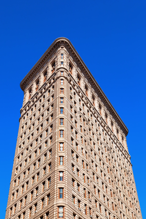 New York City, USA - October 10, 2015: Flatiron Building in Manhattan. Its a teel framed historical skyscraper, designated as NYC landmark and a National Historic Landmark and registered in Historic Places Editorial