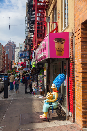 streetscene: New York City, USA - October 09,2015: streetscene with unidentified people in Little Italy, did is is once known for its large population of Italians, today exists only a few Italian stores and restaurants Editorial