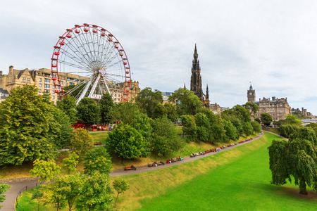 Edinburgh, Scotland - September 11, 2016: Princes Street Gardens in Edinburgh with unidentified people. It is a public park in the centre of Edinburgh, created in two phases in the 1770s and 1820s