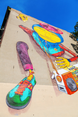 os: New York City, USA - October 09, 2015: mural of Os Gemeos in downtown Manhattan. Os Gemeos are Brasilian twins, who are Regarded as the most prominent Representatives of the Brazilian street art