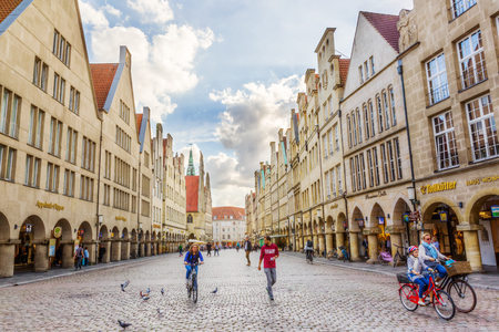 Muenster, Germany - September 26, 2016: Prinzipalmarkt with unidentified people. Its the historic marketplace shaped by historic buildings with picturesque pediments attached to one another Editorial