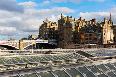 Edinburgh, Scotland, UK - September 10, 2106: view of the old town over the roofs of the Waverly Station. The old town with many Reformation-era buildings is protected by UNESCO World Heritage Site