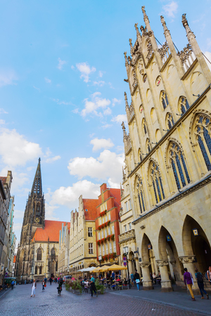 Muenster, Germany - September 25, 2016: buildings at the Prinzipalmarkt with unidentified people. The Prinzipalmarkt is the historic principal marketplace of Muenster, shaped by historic buildings Editorial