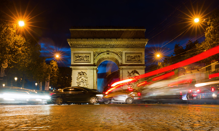 champs elysees: Paris, France - October 19, 2016: Arc de Triomphe at the Champs-Elysees in Paris at night. It is one of the most famous monuments in Paris standing in the centre of the Place Charles de Gaulle Editorial