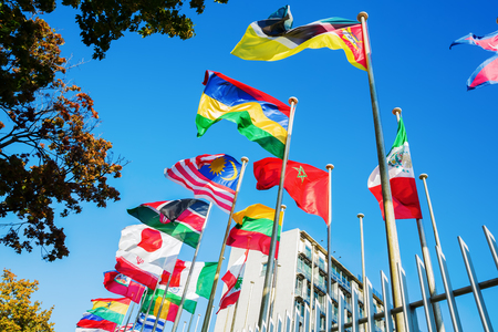 world flags in front of UNESCO headquarters in Paris, France