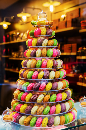 shop window: tree of macarons in the window display of a pastry shop Editorial