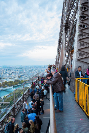 Paris, France - October 16, 2016: unidentified people on the Eiffel Tower in Paris. The Eiffel Tower is the most-visited paid monument in the world, 6.91 million people ascended it in 2015.