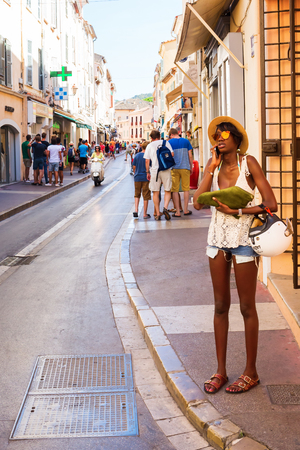 tropez: Saint Tropez, France - August 03, 2016: unidentified people on a street in Saint Tropez. St Tropez is a seaside resort at the Cote dAzur and popular for the European and American jet set Editorial