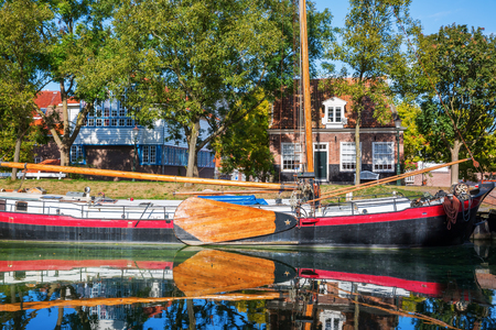 typical flat-bottomed boat at the IJsselmeer in Enkhuizen, Netherlands Stock Photo