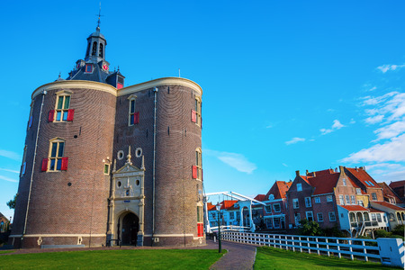 Enkhuizen, Netherlands - October 09, 2016: cityscape with town gate and unidentified people. Enkhuizen has today one of the largest marinas in the Netherlands