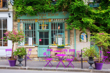 Paris, France - October 18, 2016: picturesque cafe on the Ile de Cite. Ile de Cite is a Seine Island, it is the centre of Paris and the location where the medieval city was refounded.