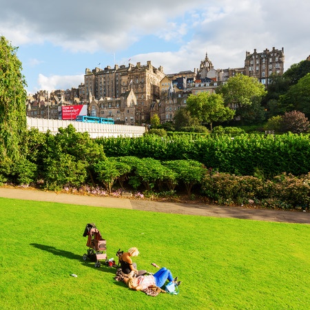 princes street: Edinburgh, Scotland - September 10, 2016: unidentified people at Princes Street Gardens with view to the old town. The old and new town of Edinburgh are listed as UNESCO World Heritage Site Editorial