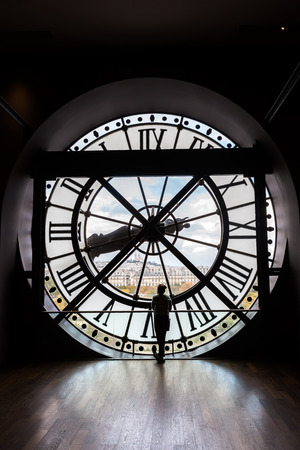 Paris, France - October 19, 2016: giant clock of Musee dOrsay with unidentified people. It houses in the former Gare dOrsay, a Beaux-Arts railway station. It is one of the largest museums in Europe